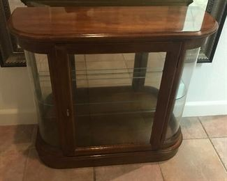 Console with glass shelves and doors