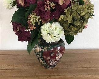 Faux floral in Asian style container
