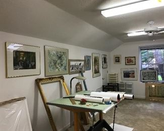 Drafting table, paintings and storage
