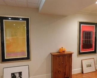 Many pieces of framed art work