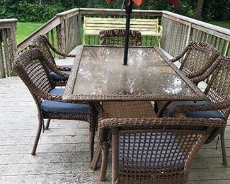Wicker patio table with 6 chairs and umbrella