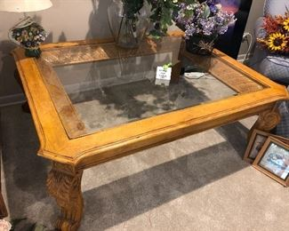 Carved wooden coffee table with glass top