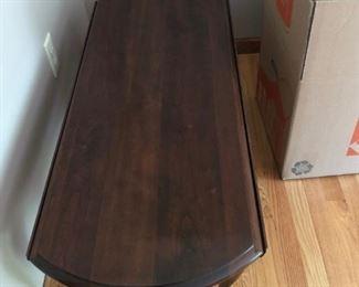 Oval drop leaf coffee table