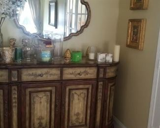 credenza and mirror and all decorative pieces