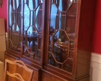 side view of china cabinet. This set has matching table, chairs, buffet as well
