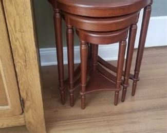 "stackable wooden tables. 3 tables 26"" tall, 23"" tall and 20"" tall. Largest one is 21"" round"