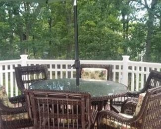 Patio set with umbrella and all chair cushions, pristine condition.