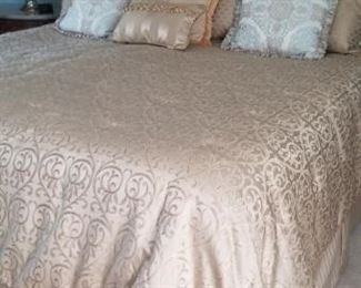 king bed and all bedding and furniture. Night stands with marble tops