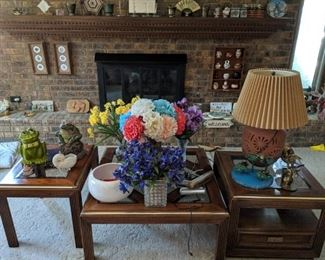 coffee table with matching end tables, cookie jars, lamps, flower arrangements