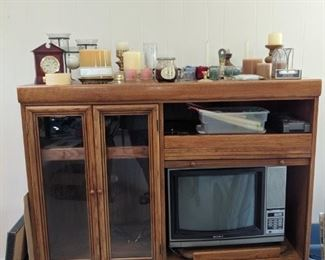 entertainment center and candles of all sizes