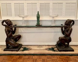 This Exquisite Sculpture signed CM Clodion is currently used as a console table.  It depicts two servants holding a litter and was possibly a part of a larger grouping by the artist Claude Michel (1738-1814) who worked under the name Clodion.