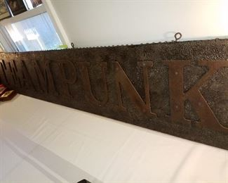 Very large metal steampunk sign