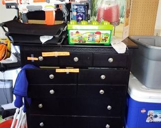 Black dresser, coolers, toy gun and more