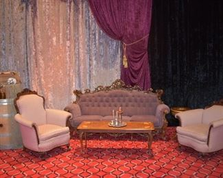 ornate  purple couch with pink arm chairs