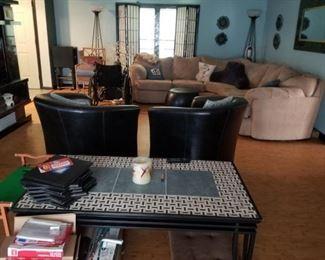 Custom tile coffee table, tan microsuade sectional sofa.