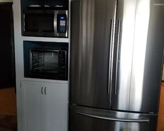 Stainless steel French-door refrigerator/freezer. Stainless steel microwave. Large toaster oven/broiler.