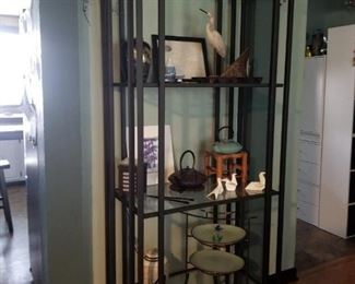 """Two of these metal and glass shelving units available, approx. 3'w x 10""""d x 6'h."""