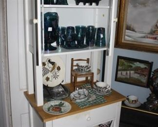 Kitchen cabinet.  Top two shelves are Carnival glass-blue.  Bottom is mugs.  Just check stuff out.