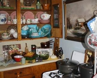 Kitchen area.  Great, older gas stove,  Calphalon cookware.  Take a moment and look.