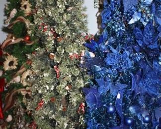 There was one Christmas tree in every room-even the bath rooms.  And he didn't take them down after Christmas.  He just moved them into his clothes room.  here are three.  They are all very tasteful and attractive