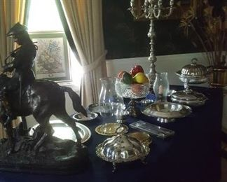 Silver plate, bronze statue, and candelabrum lamp