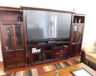 "Huge 73"" Flat screen TV. The entertainment unit can be broken up into three individual pieces. Use the end units as stand alone cabinets."