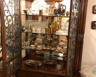 Lighted China Cabinet has touch lighting on the outside, missing one side glass and has cracks in mirror, still gorgeous!
