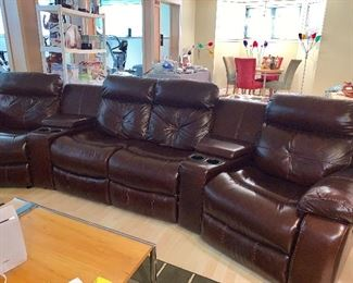 4  leather Theater recliner chairs w/2 flip up storage boxes & 4 cup holders - all 4 chairs recline and the 2 end chairs rock - Couch is from Macy's and in perfect condition