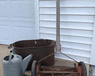 Primitive in my mind - lawn mower.  Vintage sprinkler cans (more than just this one) and tin tub.