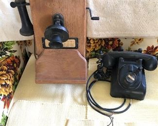 The wall phone I don't know the specific name.  The black rotary phone goes back in my family to the 20's or  30's. It is a Leich Rotary Phone.