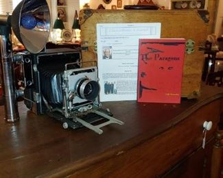 Cliff Chandler photography equipment with case and one of his books