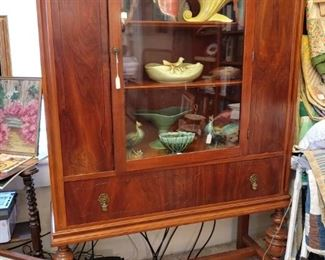 China cabinet loaded with collectible manufactured pottery vases and planters!