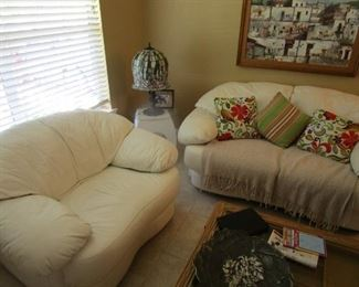 Twin white leather love seats