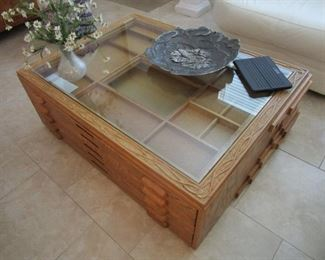Custom Made Wood Coffee Table with Display Compartments, chart drawers and hand carved frame