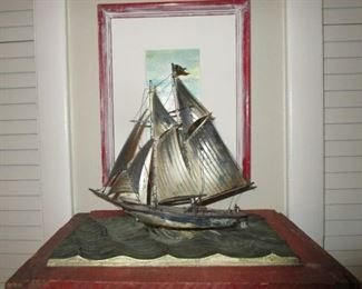 Sterling silver sail boat atop sterling ocean pedestal.