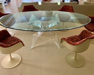 Vintage oval glass table on lucite base (Lion in Frost Butterfly?  could not find signature).  Set of six vintage midcentury modern Knoll Tulip arm chairs.