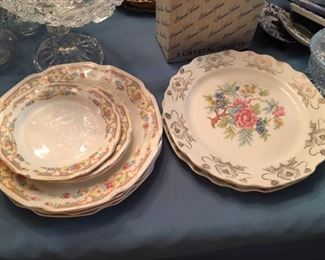 Early 1900s dinnerware. Left is unmarked and has two matching platters. Right is Dorlexa (George White) hand-painted 22K gold rimmed dinnerware; few large and small plates and one cracked saucer.