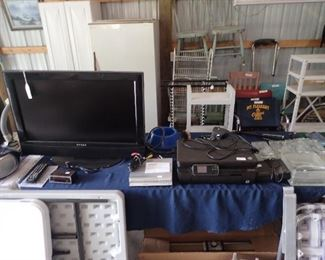 Dynex T.V. DVD Player.Printer. Antenna Rotor. Lawn Chairs.Old Wooden Chairs. Stadium Seats.