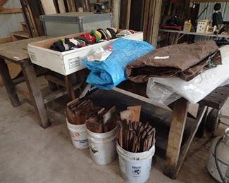 Work Tables. Tarps. Baseball Caps. Buckets of Wood Shingles.