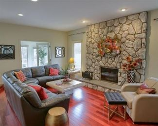 Every interior thing you see in this picture is for sale!  Beautiful L-Shape Couch, Large sandy colored Chair, Coffee Table, Elegant padded black chair with golden toned metal legs, Planters, Artwork, Lamps, Side Tables and Magazine Rack!