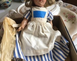 Very old all porcelain doll jointed and eyes work