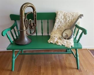 "Bench with ""Dixie"" banjo/mandolin, crocheted spread, Brass horn."
