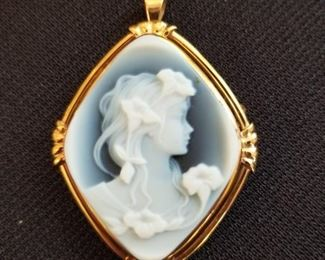14k gold cameo with what appears to be blue agate, has a pin on the back as well