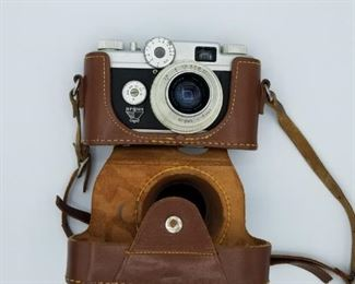 Argus C-Four camera and snap-on leather case