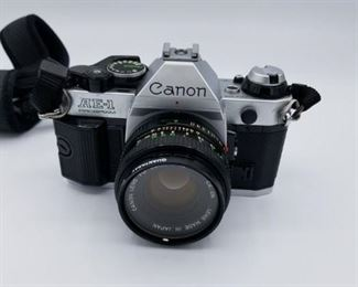 Canon AE-1 camera with lens