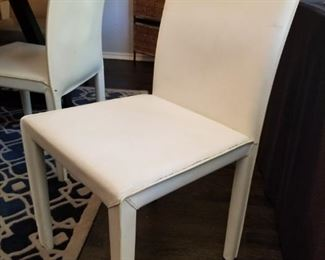 4 white leather chairs