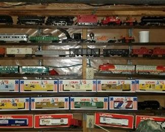 This is only a small sampling of the trains and accessories included in this sale.  There are table and boxes of trains as well.