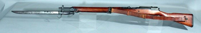 Japanese Arisaka Type 99 7.7x58mm Bolt Action Rifle SN# 84763 With Leather Sling And Bayonet