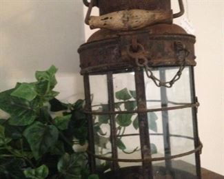 One of two matching rustic lanterns
