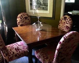 A nice older Lane game table flanked by four beautiful velvet upholstered chairs